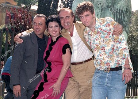 A Picture Dated 24 September 1990 Shows Italien Writer Giorgio Faletti (l) Posing with Lorenzo Cherubini Aka Jovanotti (r) Marisa Laurito (2-l)and Italian Anchorman Pippo Baudo (2-r) in Rome Italy Faletti Died of a Lung Cancer at Molinette Central Hospital in Turin on 04 July 2014 Faletti was 63 Italy Rome