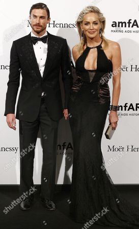 Us Actress Sharon Stone Poses with Her Boyfriend Martin Mica During the Amfar Milano 2012 Gala in Milan Italy 22 September 2012 Amfar is a Charity Gala Organized During the International Fashion Week Italy Milan