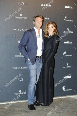 Prince Emanuele Filiberto of Venice and Piedmont (l) and His Wife French Actress Clotilde Courau Attend the Vogue Italia 50th Anniversary Event in Milan Italy 21 September 2014 Italy Milan