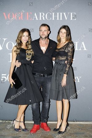 Stock Photo of A Picture Made Available on 22 September 2014 Shows German Designer Philipp Plein (c) and Ludivine Pont (l) Arriving For the Vogue Italia 50th Anniversary Event in Milan Italy 21 September 2014 Italy Milan
