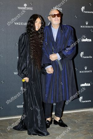 A Picture Made Available on 22 September 2014 Shows Swiss Photographer Michel Comte (r) and His Wife Ayako (l) Arriving For the Vogue Italia 50th Anniversary Event in Milan Italy 21 September 2014 Italy Milan