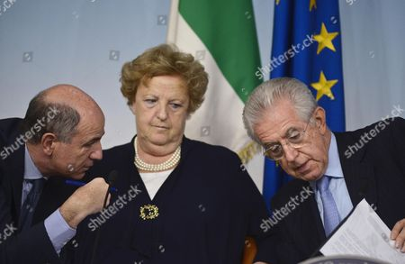 Italian Prime Minister Mario Monti (r) with Minister of Economic Development Corrado Passera (l) and Interior Minister Anna Maria Cancellieri (c) Discuss a Ppoint During a News Conference After a Meeting of the Council of Ministers at the Chigi Palace in Rome Italy 08 June 2012 the Council was Discussing a Variety of Topics Including the Handling of the Situation Following the Recent Earthquakes in the Northern Italian Emilia Romagna Region As Well As Economic and Italian Media Issues Italy Rome