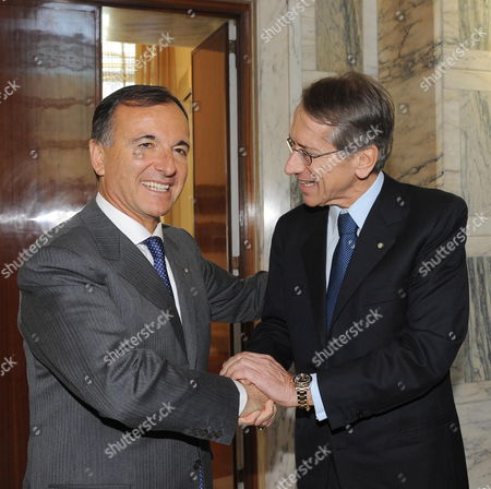 New Italian Foreign Minister Giulioterzi Di Sant'agata (r) Shakes Hands with Outgoing Foreign Minister Franco Frattini at Farnesina Palace Rome 17 November 2011 Italian Prime Minister Mario Monti Unveiling His Cabinet on 16 November Expressed Confidence That He Would Succeed in Calming International Market Concerns Over Italy's Credit-worthiness Italy Rome