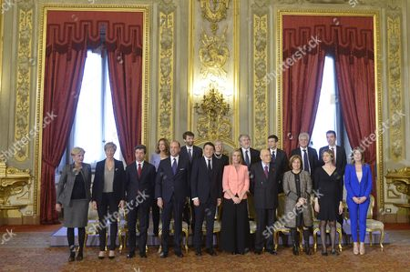(l-r) the New Italian Cabinet Minister of Economic Development Federica Guidi Minister of Defense Roberta Pinotti Minister of Justice Andrea Orlando Minister of Health Beatrice Lorenzin Minister of Interior Angelino Alfano Minister of Cultural Property Dario Franceschini Prime Minister Matteo Renzi Minister of Education and Research Stefania Giannini Minister of Foreign Affairs Federica Mogherini Minister of Welfare Giualiano Poletti President Giorgio Napolitano Minister For Transport Maurizio Lupi Minister of Regional Affairs Maria Carmela Lanzetta Minister of Environment Gianluca Galletti Minister For Public Administration Marianna Madia Minister For Agriculture Maurizio Martina and Minister For Relations with Parliament Maria Elena Boschi Pose For a Picture After the Swearing in Ceremony of the New Government at Quirinale Palace Rome Italy 22 February 2014 Thirty-nine Year Old Prime Minister Matteo Renzi is the Youngest Leader in Italy's 163-year History As a United Country Italy Rome