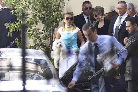 Carrying Her White Poodle Francesca Pascale (c) Girlfriend of Former Italian Prime Minister Silvio Berlusconi and Marina Berlusconi His Eldest Daughter Leave His Residence Palazzo Grazioli in Rome on August 3 2013 Following the 76 Year Old Conviction Earlier This Week the Exp Premier May Have to Spend 12 Months in Just One of His Portfolio of Houses - Including Grazioli - As a Form of House Arrest Italy Rome