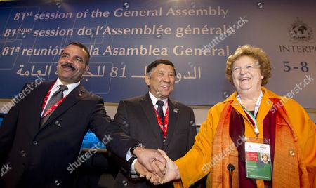 The President of Interpol the World's Largest International Police Organization Khoo Boon Hui of Singapore (c) and Interpol Secretary General Ronald K Noble (l) Shake Hands with Italian Interior Minister Anna Maria Cancellieri (r) During the Opening Session of Interpol's 81th General Assembly in Rome Italy 05 November 2012 the Assembly Takes Place From 05 to 08 November Italy Rome