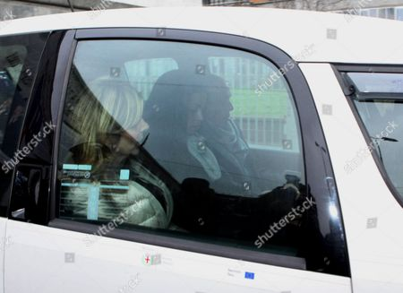 Moroccan-born Karima El-mahroug (c) Also Known As Ruby Rubacuori (ruby Heart Stealer) is Accompanied by Unidentified People in a Car As She Leaves the Court of Milan After Being Heard During the Trial of Former Italian Prime Minister Silvio Berlusconi in Milan Italy 14 January 2013 Judges in Silvio Berlusconi's Sex Trial on 14 January Rejected the Ex-premier's Call to Suspend the Case Until After the 24 and 25 February General Election in a Surprise Move They Said They Would not Demand the Testimony of the Young Woman at the Centre of the Case Instead Said the Judges They Would Rely on Statements That Karima El Mahroug Better Known As Ruby the Heart-stealer Made to Investigators in the Case El Mahroug the Young Moroccan Woman who Berlusconi is Accused of Having Paid For Sex when She was Under-age Appeared in Court Eralier the Same Morning to Give Evidence at His Trial Berlusconi Stands Accused of Having Paid the Woman For Sex when She was Under 18 the Legal Age For Prostitution in Italy and Later Using His Position to Hush Up Their Relationship Judges Also Ruled the Trial Will Proceed Despite Berlusconi's Complaint That He Would Be Too Busy Campaigning to Properly Defend Himself Italy Milan