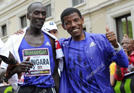 Stock Picture of Kenneth Mungara (l) of Kenya Celebrates with Ethiopian Long-distance Track and Road Running Athlete Haile Gebrselassie After Winning the 15th Men's Race of the Suissegas Milano Marathon in Milan Italy 12 April 2015 Italy Milan