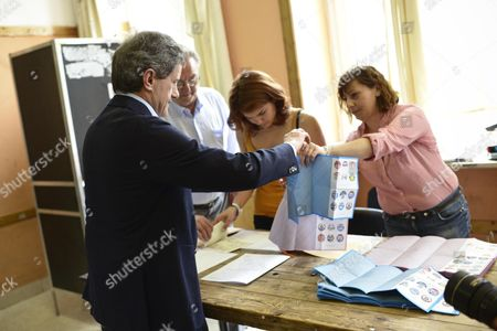 Centre-right Parties Candidate Incumbent Mayor of Rome Gianni Alemanno (l) Votes in the Run-off Election For Rome's Mayor at a Polling Station in Rome Italy 09 June 2013 Italy Rome