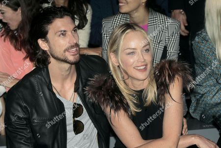 Us Actress Sharon Stone (r) and Her Boyfriend Argentinian Model Martin Mica Attend the Fendi Show During the Milan Fashion Week in Milan Italy 22 September 2012 Spring/summer 2013 Collections Are Presented at the Milano Moda Donna From 19 to 25 September Italy Milan