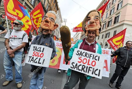 Demonstrators Wear Masks of Prime Minister Mario Monti and Elsa Fornero the Italian Welfare Minister As They March with Signs Stating 'Cut Only Cuts' and 'Only Sacrifice Sacrifices' in Rome Italy 27 October 2012 As They Take Part in the 'No Monti Day' Rally a Day of Protest was Organized by Trade Unions Political Parties Movements and Associations to Say No to Insecurity Redundancies and Unemployment Italy Rome