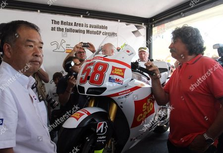 Honda Hrc Has Presented Two Bikes to Paolo Simoncelli (r) His Son's Marco's Rc212v Race Machine and a Marco Inspired During the Grand Prix of Italy Tim at the Mugello Circuit Central Italy 14 July 2012 Italian Moto Gp Rider Marco Simoncelli who Died Last Year Italy Scarperia (fi)