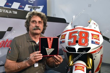 Paolo Simoncelli the Father of Late Italian Motogp Rider Marco Simoncelli who Died in a Crash in October 2011 During the Malaysian Grand Prix Shows a Medal During the Motorcyling Grand Prix of Italy at the Mugello Circuit Scarperia Central Italy 30 May 2014 Marco Simoncelli Will Be Posthumously Inducted Into the Motogp Hall of Fame Italy Mugello