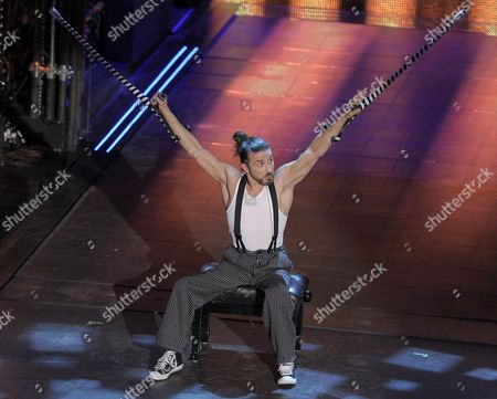 Stock Photo of German Dancer and Acrobat Dergin Tokmak Performs During the Third Night of the Sanremo Italian Song Festival at the Ariston Theatre in Sanremo Italy 20 February 2014 Italy Sanremo
