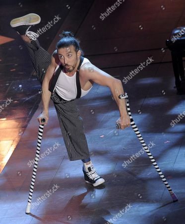 Stock Image of German Dancer and Acrobat Dergin Tokmak Performs During the Third Night of of the Sanremo Italian Song Festival at the Ariston Theatre in Sanremo Italy 20 February 2014 Italy Sanremo
