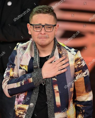 Italian Singer Rocco Hunt Reacts After Winning the 'Young Singer' Prize During the Fourth Night of of the Sanremo Italian Song Festival at the Ariston Theatre in Sanremo Italy 22 February 2014 Italy Sanremo