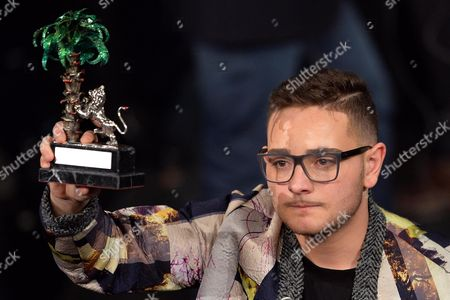 Italian Singer Rocco Hunt Celebrates After Winning the Prize 'Young Singer' During the Fourth Night of of the Sanremo Italian Song Festival at the Ariston Theatre in Sanremo Italy Early 22 February 2014 Italy Sanremo