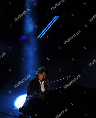 Stock Photo of Italian Singer Cristiano De Andr? on Stage During the Fourth Night of of the Sanremo Italian Song Festival at the Ariston Theatre in Sanremo Italy 21 February 2014 Italy Sanremo
