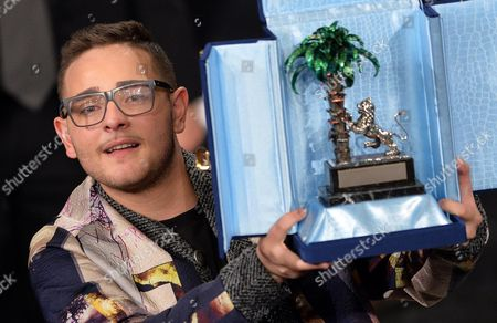 Italian Singer Rocco Hunt Celebrates After Winning the Prize 'Young Singer' During the Fourth Night of of the Sanremo Italian Song Festival at the Ariston Theatre in Sanremo Italy 22 February 2014 Italy Sanremo