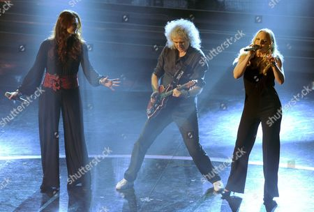 Irene Fornaciari (l) with Brian May (c) of Legendary British Glam-rock Band 'Queen' and Kerry Ellis (r) Jointly Perform on Stage of the Ariston Theatre During the Third Day of the Sanremo Festival in Sanremo Italy 16 February 2012 Italy Sanremo