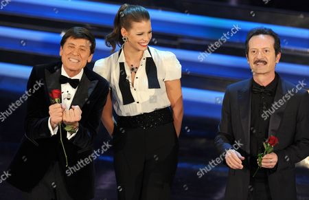 Italian Actor Rocco Papaleo (r) and Italian Show Host Gianni Morandi (l) Flank Czech Model Ivana Mrazova (c) As They Appear on Stage of the Ariston Theatre During the Fourth Day of the Sanremo Festival in Sanremo Italy 17 February 2012 Italy Sanremo