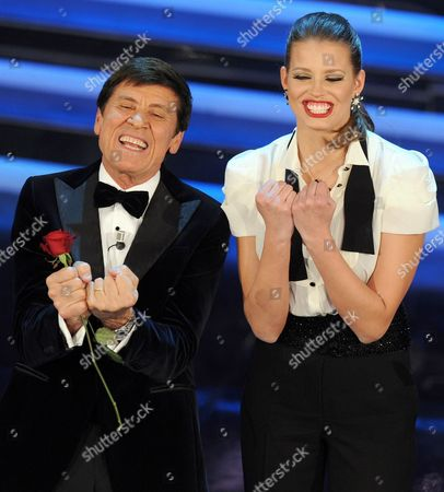 Italian Show Host Gianni Morandi (l) and Czech Model Ivana Mrazova (r) Perform on Stage of the Ariston Theatre During the Fourth Day of the Sanremo Festival in Sanremo Italy 17 February 2012 Italy Sanremo