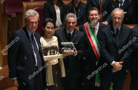 (l-r) Former Mayor of Rome Francesco Rutelli Myanmar Opposition Leader Aung San Suu Kyi Former Soccer Player Roberto Baggio Rome's Mayor Ignazio Marino and Former Mayor of Rome Walter Veltroni During the Ceremony For Receiving the Honorary Citizenship of Rome at Campidoglio in Rome Italy 27 October 2013 Aung San Suu Kyi Collected Her Honorary Citizenship of Rome 19 Years After Being Offered the Honour Italy Rome