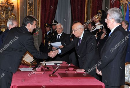 Italy's New Prime Minister Mario Monti (r) Stands with Italy's President Giulio Napolitano (2-r) While Italian Education Minister Francesco Profumo (l) Swears-in During the Swearing-in Ceremony of the New Italian Government at the Quirinale Palace the Presidential Palace in Rome Italy 16 November 2011 Reports State That Prime Minister Mario Monti was Sworn in on 16 November 2011 to Lead Italys 63rd Government Since the End of World War Ii Italy Rome