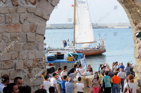 Crowd Gathers As Charlie Gilkes (back-r) and His Wife Anneke Von Trotha Taylor (back-l) Stand on a Boat After Their Wedding Ceremony in Monopoli Italy 19 September 2014 British Pince Harry and Pippa Middleton Sister of Britain's Catherine Duchess of Cambridge Were Among the Guests who Attend the Marraige Italy Monopoli