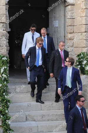British Prince Harry (c) Leaves a Church After Attending the Wedding Ceremony of Charlie Gilkes and Anneke Von Trotha Taylor in Monopoli Italy 19 September 2014 Pippa Middleton Sister of Britain's Catherine Duchess of Cambridge was Also Among the Guests who Attend the Marriage Italy Monopoli