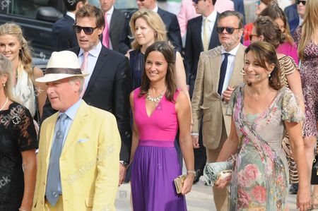 Stock Image of Pippa Middleton (c) Sister of Britain's Catherine Duchess of Cambridge and Her Mother Carole (r) Arrive For the Wedding Ceremony of Charlie Gilkes and Anneke Von Trotha Taylor in Monopoli Italy 19 September 2014 British Prince Harry was Also Among the Guests who Attend the Marriage Italy Monopoli