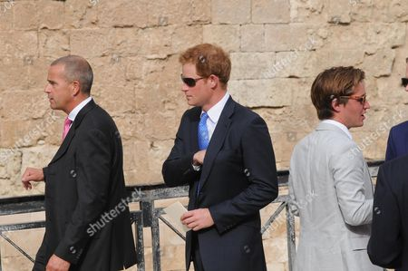 British Prince Harry (c) Arrives For the Wedding Ceremony of Charlie Gilkes and Anneke Von Trotha Taylor in Monopoli Italy 19 September 2014 Pippa Middleton Sister of Britain's Catherine Duchess of Cambridge was Also Among the Guests who Attend the Marriage Italy Monopoli