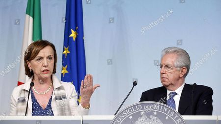 Italian Minister of Labor Elsa Fornero (l) and Prime Minister Mario Monti (r) Speak During a Press Conference After a Cabinet Meeting in Rome Italy 11 May 2012 Italy Roma