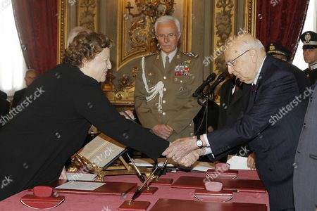 Stock Picture of New Italian Justice Minister Anna Maria Cancellieri (l) Shakes Hands with Italian President Giorgio Napolitano (r) During the Swearing-in Ceremony of the New Government at Quirinal Palace in Rome Italy 28 April 2013 Italy's New Grand Coalition Government was Sworn in on 28 April Ahead of Parliamentary Votes of Confidence Next Week That Will Formally Bring to an End Weeks of Political Stalemate in the Eurozone's Third-largest Economy Italy Rome