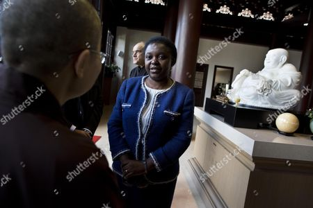 Italian Minister For Integration Cecile Kyenge (c) Speaks to the Chinese Abbess Shih Chien Li (l Back to Camera) During Her Visit to the Chinese Buddhist Temple in Rome Italy 21 November 2013 Italy Rome