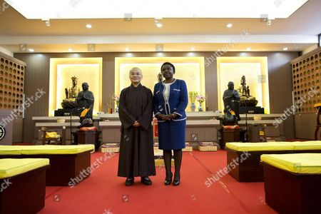 Italian Minister For Integration Cecile Kyenge (r) Poses with the Chinese Abbess Shih Chien Li (l) During Her Visit to the Chinese Buddhist Temple in Rome Italy 21 November 2013 Italy Rome