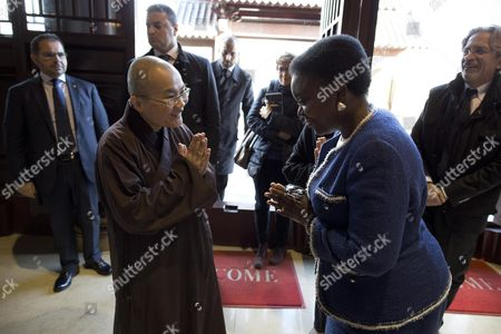 Italian Minister For Integration Cecile Kyenge (r) Greets the Chinese Abbess Shih Chien Li During Her Visit to the Chinese Buddhist Temple in Rome Italy 21 November 2013 Italy Rome