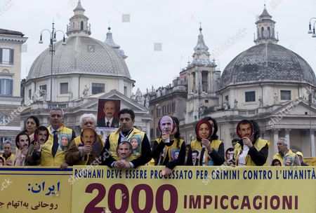 People Protest Against Iranian President Rohani and Human Rights Violations in Iran Issued by the National Council of Resistance of Iran in Piazza Del Popolo in Rome Itasly 14 November 2015 the Demonstration was Organized on the Occasion of Iranian President Hassan Rohani's Planned Visit to Paris Then Cancelled Because of Paris Attacks Italy Rome