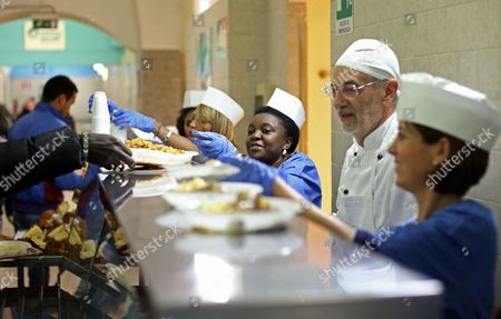 Italian Minister For Integration Cecile Kyenge (3-r) Works in the Kitchen in a Refectory For Refugees at the Astalli Center in Rome Italy 25 December 2013 Kyenge Spent Christmas in the Center Run by Jesuits Serving Lunch to Refugees Italy Rome