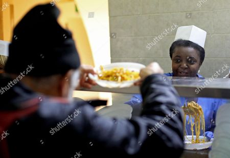 Italian Minister For Integration Cecile Kyenge (r) Works in the Kitchen in a Refectory For Refugees at the Astalli Center in Rome Italy 25 December 2013 Kyenge Spent Christmas in the Center Run by Jesuits Serving Lunch to Refugees Italy Rome