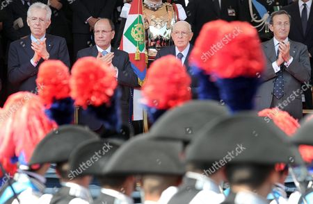 (l-r) Italian Premier Mario Monti Italian Senate President Renato Schifani Italian President Giorgio Napolitano and the President of the Chamber of Deputies Gianfranco Fini Applaud Armed Forces Personnel Marching on During the Republic Day Military Parade in Rome 02 June 2012 in the Occasion of the 66th Anniversary of the Republic Military Personnel March During the Republic Day Military Parade in Rome Italy 02 June 2012 on Occasion of the 66th Anniversary of the Italian Republic the 'Festa Della Repubblica' is Celebrated on 02 June Commemorating the Institutional Referendum of 1946 by Which the Italians Were to Choose Between Monarchy Or Republic After World War Ii and the Fall of Fascism the Republicans Won by 12 717 923 Votes Against 10 719 284 and the Royal of the House of Savoy Were Deposed and Exiled After 85 Years in Power Epa/massimo Percossi Italy Rome