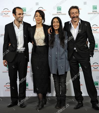 Stock Picture of (l-r) British Actor Khalid Abdalla British Director Tala Hadid Moroccan Actress Zahra Hindi and French Actor Hocine Choutri Pose During the Photocall For 'The Narrow Frame of Midnight' (itar El-layl) at the 9th Annual Rome Film Festival in Rome Italy 17 October 2014 the Festival Runs From 16 to 25 October Italy Rome