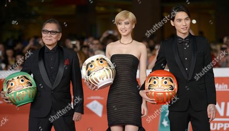 (l-r) Japanese Director Takashi Miike Japanese Actress Hirona Yamazaki and Japanese Actor Sota Fukushi Arrive For the Premiere of 'Kamisama No Iu Tori' (eng: As the Gods Will) at the 9th Annual Rome Film Festival in Rome Italy 18 October 2014 the Festival Runs From 16 to 25 October Italy Rome