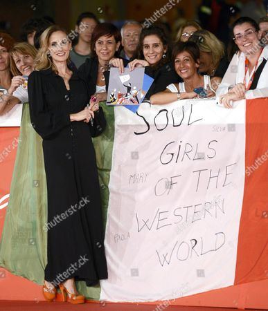 British Director and Producer George Hencken Signs an Autograph on an Italian Flag From Fans Reading 'Soul Girls of the Western World' As She Arrives For the Premiere of the Movie 'Soul Boys of the Western World Spandau Ballet the Film' at the 9th Annual Rome Film Festival in Rome Italy 20 October 2014 the Festival Runs From 16 to 25 October Italy Rome