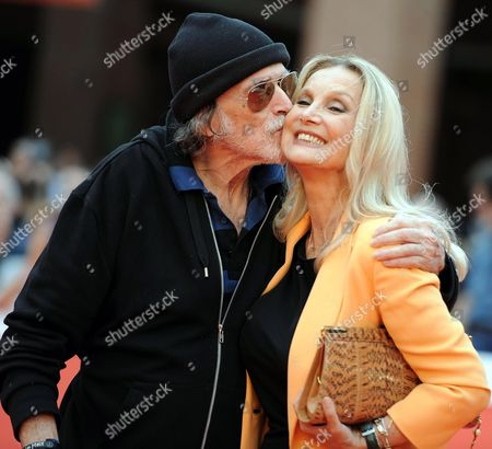 Stock Photo of Cuban-us Actor Tomas Milian (l) and German-born Actress Barbara Bouchet Pose on the Red Carpet at the 9th Annual Rome Film Festival in Rome Italy 17 October 2014 Milian Received the Marc Aurelio Acting Award at the Festival Running From 16 to 25 October Italy Rome