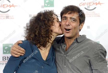 Russian Actress Ksenia Rappoport (l) Kisses Italian Actor Adriano Giannini As They Pose During the Photocall For 'La Foresta Di Ghiaccio' (the Ice Forest) at the 9th Annual Rome Film Festival in Rome Italy 23 October 2014 the Festival Runs From 16 to 25 October Italy Rome