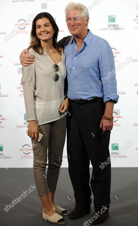 Stock Picture of Us Actor Richard Gere (r) Poses with Actress Dalia Bayazid During the Photocall For the Movie 'Time out of Mind' at the 9th Annual Rome Film Festival in Rome Italy 19 October 2014 the Festival Runs From 16 to 25 October Italy Rome