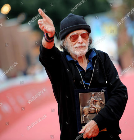 Cuban-us Actor Tomas Milian Poses on the Red Carpet After Receiving the Marc Aurelio Acting Award at the 9th Annual Rome Film Festival in Rome Italy 17 October 2014 the Festival Runs From 16 to 25 October Italy Rome