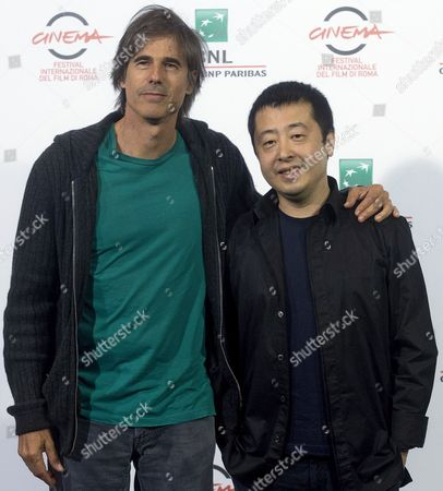 Stock Picture of Brazilian Director Walter Salles (l) Poses For the Photographers with Chinese Actor Jia Zhangke During the Photocall For the Movie 'Jia Zhangke Un Gars De Fenyang' at the 9th Annual Rome Film Festival Rome 21 October 2014 the Festival Runs From 16 to 25 October Italy Rome