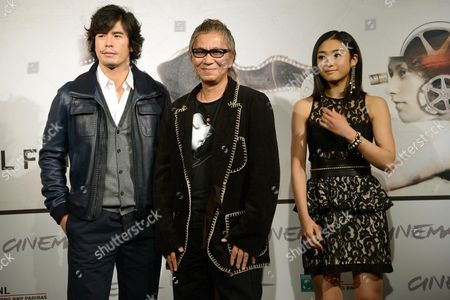 From (l-r) Japan's Actor Hideaki Ito Director Takashi Miike and Actress Erina Mizuno Pose During the Photocall For the Movie 'Aku No Kyoten' (lesson of the Evil) at the Seventh Annual Rome Film Festival in Rome Italy 09 November 2012 the Movie is Presented in Competition at the Festival That Runs From 09 to 17 November Italy Rome